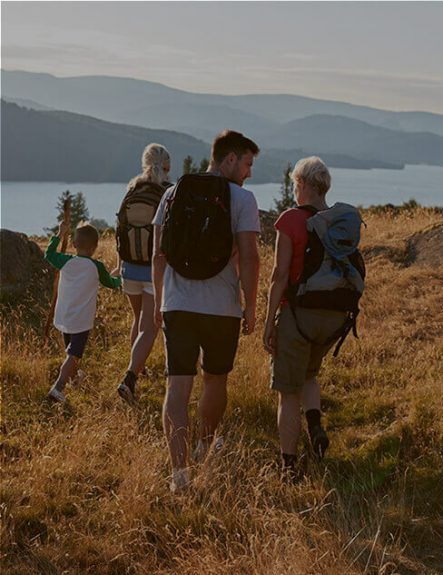 family-walking-to-have-a-picnic-at-aira-force-in-the-lake-district