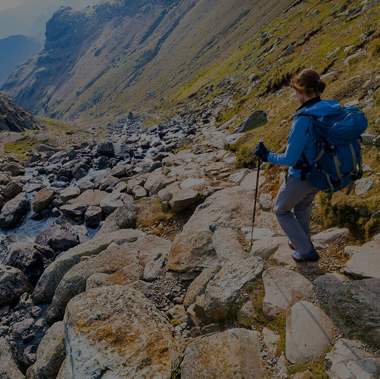 female-hiker-scrambling-down-a-fell-in-the-lake-district